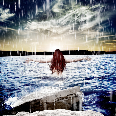 Woman under storm at sea.Freedom