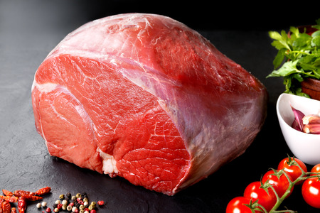 meat on grill: Raw meat. Uncooked fresh pork and beef. Red meat grilled barbecue grill in black stone background