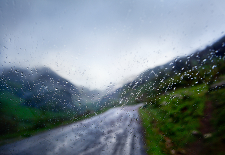 rainy day, car and the road in the rain through the window abstract image Standard-Bild