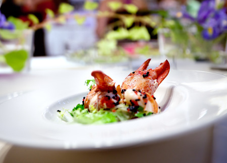 Festive meal. Restaurant lobster dish floral arrangement. Modern food for celebrations