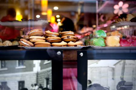 desserts and sweets. pastry shop with biscuits and cookies in the window.