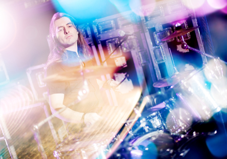 perform: Man playing drums live. Concept live music.Double exposure