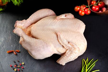Food and feed. raw meat. uncooked poultry to grilled chicken or barbecue Standard-Bild
