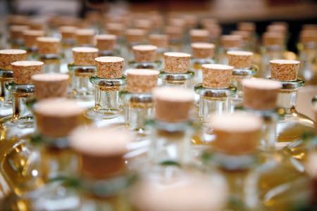 Row of glass storage jars with corks. Standard-Bild