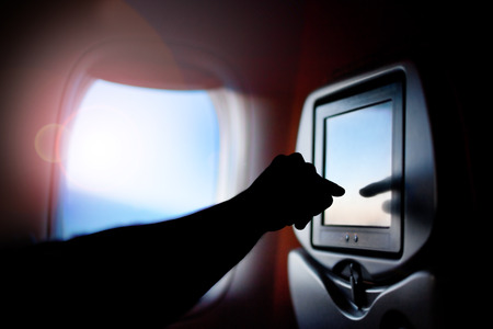 Technology. Display screen on the passenger seat of the plane. Transportation by plane
