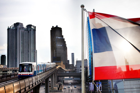 Skytrain in downtown Bangkok. Skyscraper and banner in Thailand. Transport