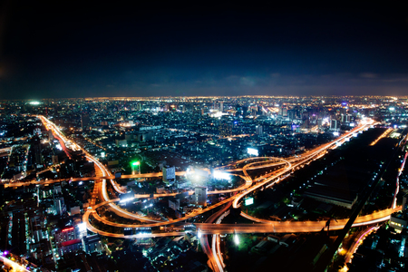 Aerial view of the motorway in central Bangkok at night, Thailand. City background