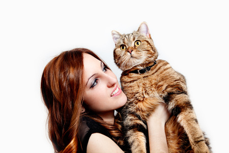 Beautiful girl with her cat on white background. People and pets. Lifestyle Standard-Bild - 118815889