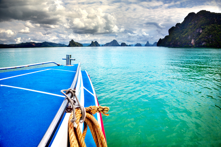 Adaman sea and wooden boat in Thailand. Beautiful tropical beach landscape in Thailand.