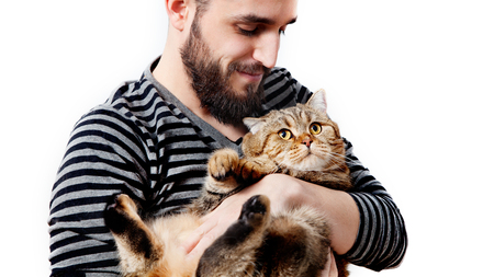 Bearded man with his beautiful cat on white background. People and pets