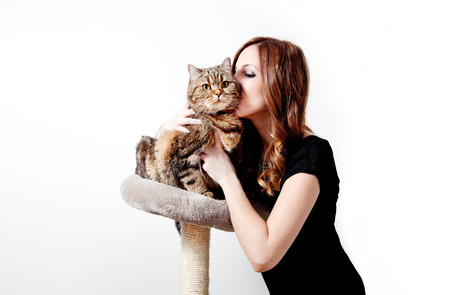 Beautiful girl with her cat on white background. Lifestyle Standard-Bild - 118816011