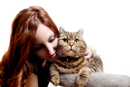 Beautiful girl with her cat on white background. People and pets Standard-Bild - 118816012