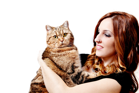 Beautiful girl with her cat on white background. Lifestyle