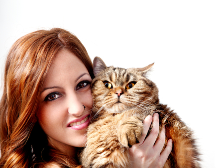 Beautiful girl with her cat on white background. People and pets. Standard-Bild - 118816020