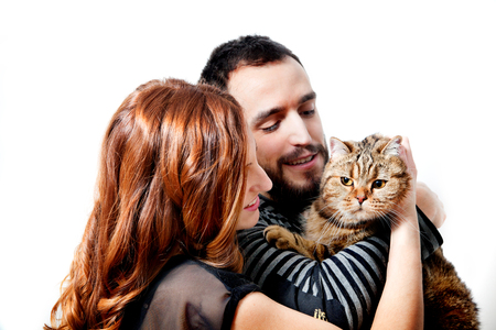 Young couple with their cat at home Couple, pets 写真素材