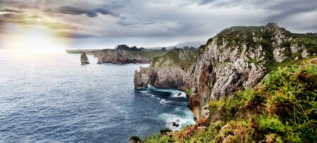 Beautiful landscape of sea coast and cliffs. Scenic panorama of the Cliffs of Hell in Spain, Asturias
