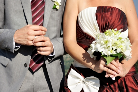 wedding ring hands: bride and groom with bouquet and wedding rings
