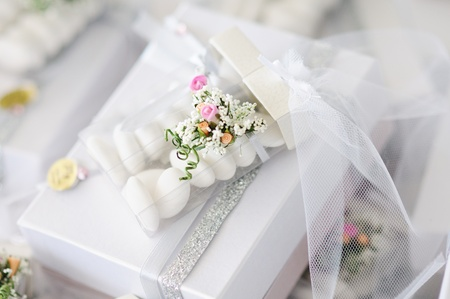 favour: Elegant Wedding Favors decorated with artificial flowers