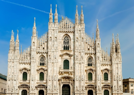 cathedrals: Milan Duomo cathedral ornate gothic spires moon blue sky Italy Stock Photo