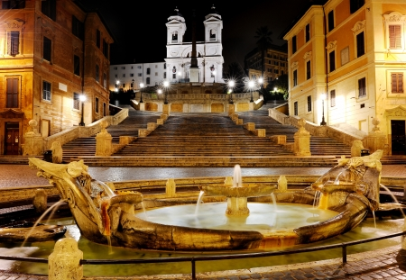 Spanish square,Fountain of the old boat and Spanish steps by night, Rome, Italy Banco de Imagens