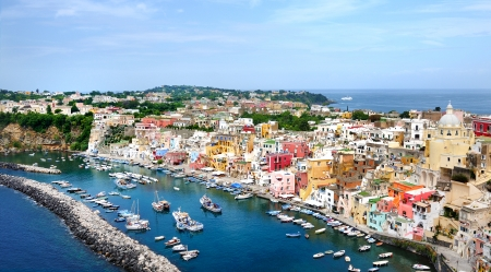 beautiful panoramic view of the colorful island of Procida in the Gulf of Naples, Mediterranean sea, Italy Banco de Imagens
