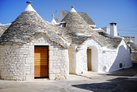 conical: Typical trulli houses with conical roof in Alberobello, Apulia, southern Italy Stock Photo