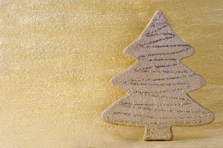 snappy: yellow Christmas tree decoration on golden background Stock Photo