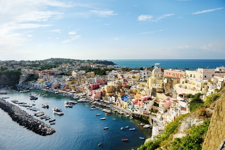 beautiful panoramic view of the colorful island of Procida in the Gulf of Naples, Mediterranean sea, Italy Imagens