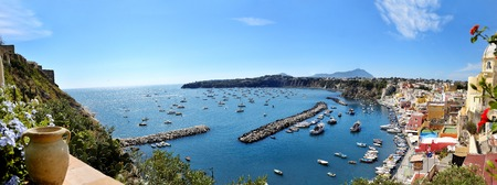 beautiful panoramic view of the colorful island of Procida in the Gulf of Naples, Mediterranean sea, Italy photo