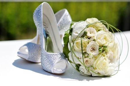 beautiful wedding bouquet of roses and wedding shoes