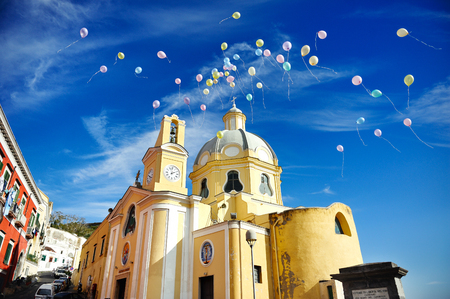 beautiful panoramic view of the colorful island of Procida in the Gulf of Naples,  church of Procida, Mediterranean sea, Italy Banco de Imagens