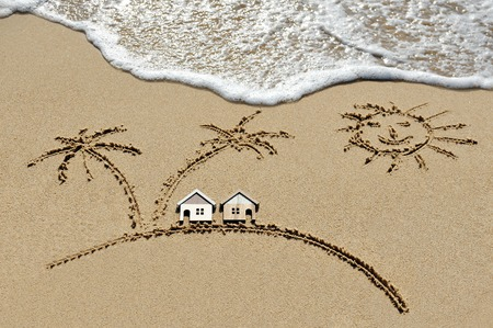 house near sea, beach, sun and palm trees - holiday concept