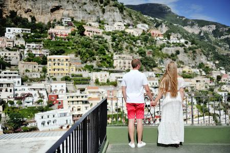 positano: couple holding hands in Positano, Amalfi Coast, Italy