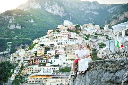 positano: happy bride and groom young couple relaxing in Positano, Amalfi Coast, Italy Stock Photo