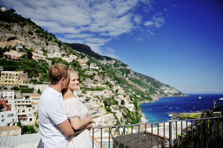 young happy couple in Positano, Amalfi coast, Italy Banco de Imagens