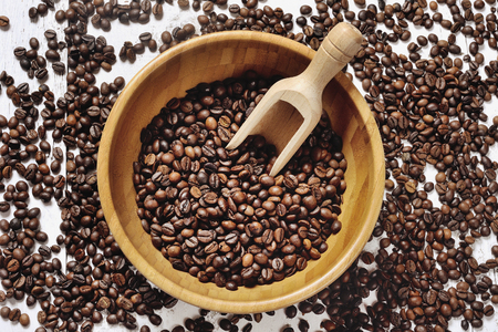 expressed: coffee beans in a wooden bowl Stock Photo