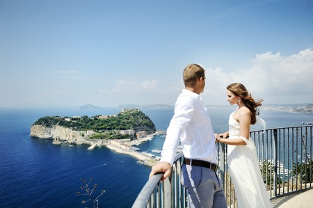 honeymoon: young beautiful couple bride and groom in wedding day in Naples, Italy Stock Photo