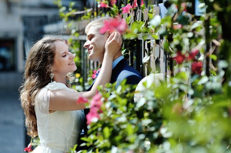 newlyweds: happy romantic couple bride and groom in wedding day tender caress in Naples, Italy