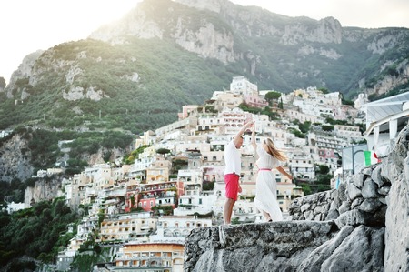 young beautiful happy couple dancing in Positano, Amalfi coast, Italy Stock Photo