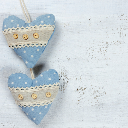 two hearts: two hearts on wooden background