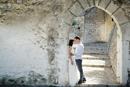 honeymoon: beautiful romantic tender couple in wedding day in Sperlonga, Italy