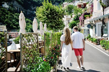 positano: young couple walking on Positano in a sunny day, Amalfi coast, Italy