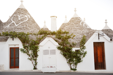 characteristic: trulli ancient characteristic houses in Alberobello, Apulia, Italy