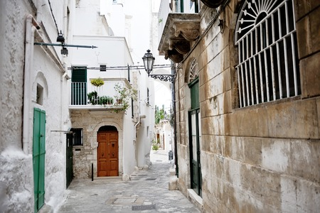 characteristic: characteristic alley in Ostuni, Apulia, mediterranean Italy Stock Photo