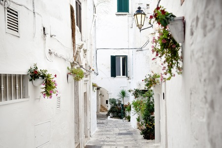 alley in white city Ostuni, Apulia, southern Italy
