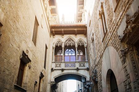 carrer: Barcelona, Spain, medieval bridge in Carrer del Bisbe street, Barri Gotic Stock Photo