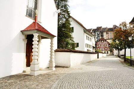 cobblestone road: Church and characteristic cobblestone road in Bremgarten, Aargau, Switzerland