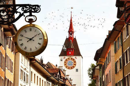 characteristic: Characteristic clock and tower bell in Bremgarten old town, canton Aargau, Switzerland Stock Photo