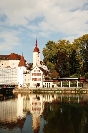 characteristic: Swiss characteristic buildings and Reuss river in Bremgarten near Zurich, canton Aargau