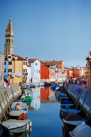 Burano island, Venice, Italy - boats in the canal and colorful houses